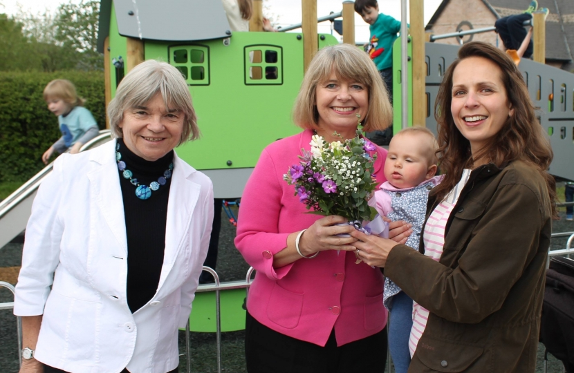 Welland parish council chair Viv Nelson, Harriett Baldwin MP and parish councillor Emma Horton-Smith with seven month old daughter Amber